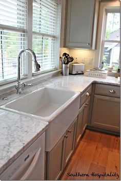 farmhouse sink; paint color on cabinetry; marble counters