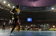 Jamaica's Usain Bolt wins the 100-meter final at the 2013 IAAF World Championships in Moscow on Aug. 11 as lightning strikes in the sky above Luzhniki Stadium.