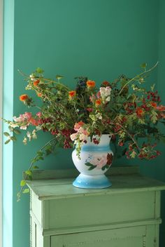 love this arrangement of flowers in old vintage pitcher