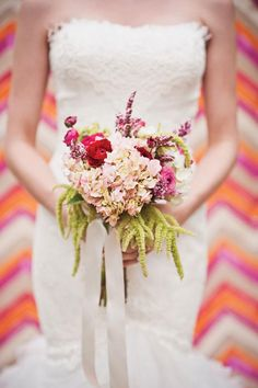 Such a simple and sweet bouquet by @Emerson EventsandDesign in our Sweet Romance gown shoot! Photo by BRC Photography. #wedding #bouquet #pink #blush #red #purple