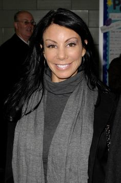 Danielle Staubs dark, long layered hairstyle