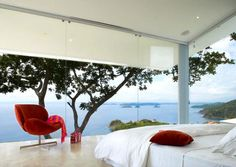 repinned by Designpass.com white bedroom with the water view