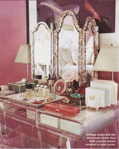 Jennifer Marsico vanity featured in Domino Magazine in her NYC apartment in downtown Manhattan in Soho. The lucite vanity and stool are from Distant Origin, the lipshell trifold mosiac mirror is from Horchow