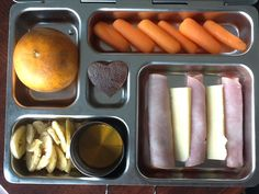 Tangerine, carrots, ham roll ups, Kerrygold cheese, banana chips and raw honey, and a apricot leather heart!