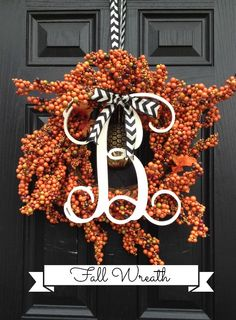 Love this fall wreath made of bittersweet and a wood monogram!