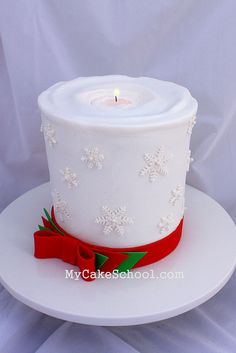 Here's a candle cake that I made in a recent video tutorial ;0) --It's buttercream with fondant accents.