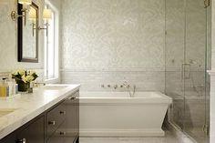 Bathroom, mosaic tiles, freestanding tub, frameless shower, white carrara marble subway tiles backsplash, marble counter top and marble tiles floors.