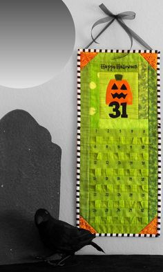 "Halloween Countdown Calendar - ""Eerie-sistable"" Quilted Pumpkin in Lime Green and Orange. $85.00, via http://whimziequiltz.etsy.com"