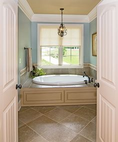 Master bath of The Fincannon Plan 1234 http://www.dongardner.com/plan_details.aspx?pid=3746  The master suite is a luxurious retreat with a fireplace, porch access, his and hers walk-in closets and a huge bathroom. #Home #Designs #Craftsman #Bathroom