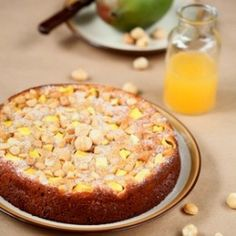 Mango Macadamia Upside Down Cake This is a variation of the pineapple upside down cake that everyone is familiar with..  The combination of ...