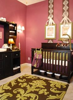 I love this bold nursery. The pink is a bit vibrant for me personally -  I might have only used it as a vertical stripe pattern or one accented wall. Perhaps a tan stencil on a wall to break up the bold pink...