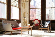 Interior by stylist Aaron Hom. Love the original typography on the windows, and the views!