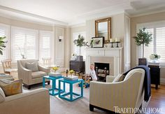 Benjamin Moore Manchester Tan on the walls, love the pop of turquoise on the tables..