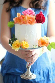 A few flowers make a simple cake wedding-worthy.