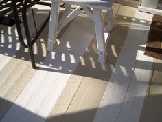 First, I painted the entire porch with plain white porch paint purchased at Lowes. Then, after it completely dried, marked off three planks at a time with painter's tape and painted each alternating group of planks with Benjamin Moore Manchester Tan that I already had. To protect it, I put several coats of non-yellowing floor polyurethane.