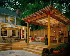 The stairs, deck, and gazebo would be perfect for a hot tub in our yard. And the lattice along the perimeter is exactly what we're doing around our yard.