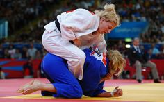 Kayla Harrison wins first american judo gold, ever-Getty- she also struggled thru sexual abuse from her first judo coach with the help of her second coach, olympic bronze medal winner Ronda Rousey