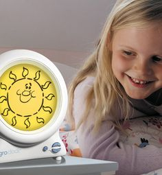 what a great idea. Its a gro-clock that you set the time for the sun to come up and it teaches kids to stay in bed until they see the sun