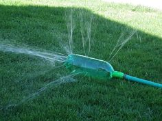 diy sprinkler plastic bottles, soda bottles, lawn games, water fun, summer activities, redneck, kids, summer fun, garden