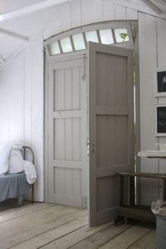 gray door + white walls + light wood floors