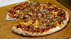 Joe Momma's The Incinerator Spicy Pizza. Calories: n/a, but if the calories don't kill you, the japeños, habaneros, wasabi, Siracha and ghost chili will.