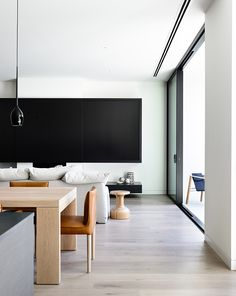 white walls + wood floors + wood details + living/dining space