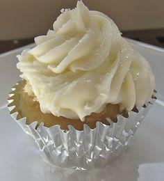 wedding cake cupcake. almond butter cream frosting on white velvet cake.