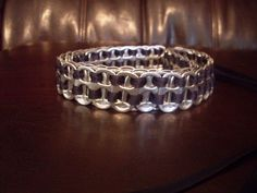 A cool belt made out of soda can tabs.  Who wants to save theirs for me?