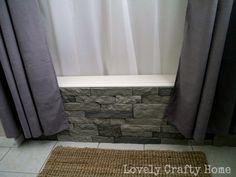 Update your boring prefab tub with Airstone for cheaper than real stone. It looks amazing!