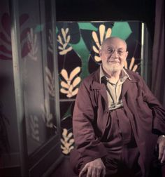 Gjon Mili, Portrait of artist Henri Matisse at his home in Nice with stained glass panels in background, 1949