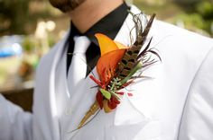 Feather boutonniere.