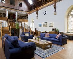 Converted church in Northumberland, England. Love the bookcases in the loft.