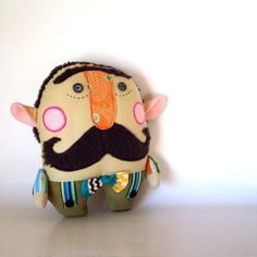 I don't usually pin dolls, but this guy's ears did  me in. Sebastian a Mustache Man by PinkCheekStudios