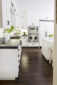 Corona del Mar Beach Home from Houzz.com.  I love the look of the white cabinets and that floor ---OMG!