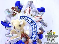 Football Roses and Baseball Roses adorn this sports-themed homecoming mum.   Sports Roses are available here:  http://sportro.se/mums-garters