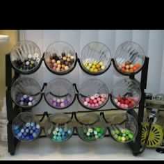 Genius.  You can find wine racks a dime a dozen at yard sales and use wide mouth mason jars.  Could use on the counter for silverware or other kitchen gadgets.  Or for crayons, markers, pencils, pens etc.  love