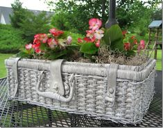 "An old picnic basket is ""antiqued"" and turned into a planter, by Confessions of a Plate Addict"