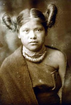 Here for your browsing pleasure is an extraordinary photo of Primitive Style Hair Dressing. It was made in 1921 by Edward S. Curtis.    The photo documents Hopi girl, half-length portrait.    We have compiled this collection of photos mainly to serve as a vital educational resource. Contact curator@old-picture.com.    Image ID# 64A70131