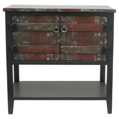 Perfect for stowing extra throws in the den or table linens in your dining room, this eye-catching wood cabinet features multicolor distressing and a bottom ...
