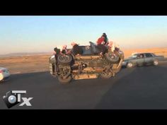 MUST SEE - Saudi Men Changing Tires While Driving!