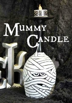 Another Halloween project from a wine goblet, this time an easy to paint mummy candle.