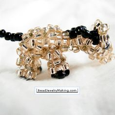 Beaded pony - wonder how hard it would be to do basic MLP charms from this pattern.