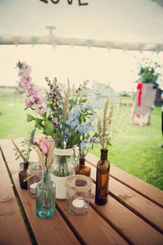 random various jars for vintage rustic country wedding feel - these you can collect from your friends  garage sales and barely spend a dime! Shabby Chic at it's best.