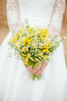 bridal bouquet with yellow and tiny little Asters