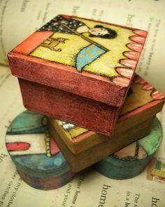 Papier mache boxes... Love the muted colours.