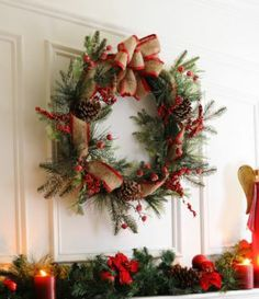 Add our new Frosted Red Berry Wreath above your mantle, and watch as this warm and inviting accent ties in all of your holiday decor! #Kirklands #Home #CozyChristmas #Wreath