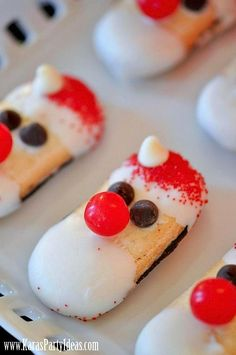 Santa cookies made using Milano cookies and candy melt! Perfect for a Christmas Party! Via Kara's Party Ideas- THE place for all things party! #blogherholidays