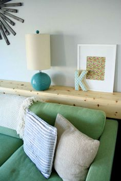 Wooden ledge - an interesting take on the behind the sofa table. Clever and space saving with lots of possibilities for decor!