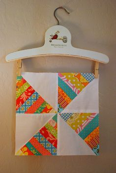 quilt block card inspiration ... String-Wheel ... layer up strips of bright patterned paper ,,, cut into half squares on the diagonal ... alternate with white pieces  ... good use for precious scraps ....