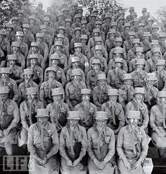 "In a photo that speaks of fear, bravery, and an unknown threat, members of the Women's Auxiliary Army Corps, commonly known as WAACs, don their first gas masks at Fort Des Moines, Iowa. The female troops were famously praised by General Douglas MacArthur, who called them ""my best soldiers."""